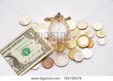 Old Silver Pocket Watch Putting On Various Sizes Coin Stack And Have One Dollar Cash Beside It With