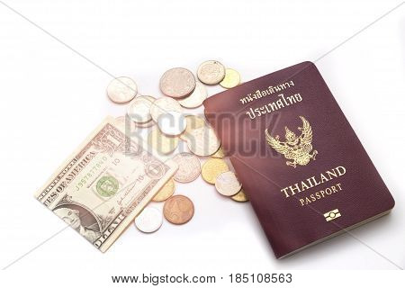 Passport Putting On Various Sizes Coin Stack And Have One Dollar Cash Beside It With White Backgroun