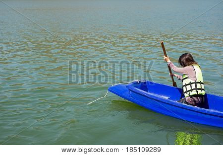 Young Woman Equip Life Jacket  Boating Forward. She Not Looking Around Herself Have Blue Sea Backgro
