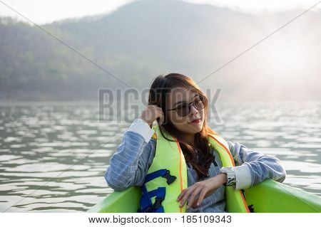 Young Woman Equip Life Jacket Sitting Relaxing On Prow. She Looking Side Around Herself Have Sea And