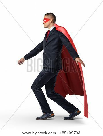A superhero in a business suit and a red cape keeping his balance on an invisible rope. Success and failure. Risk management. Insecurity.
