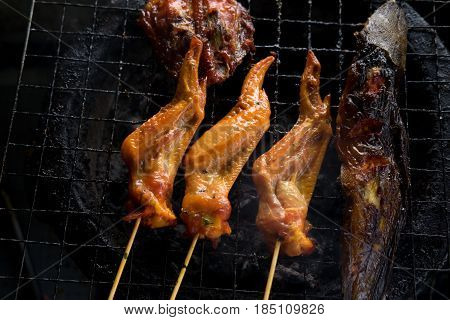 Top View. Chicken Wing And Catfish Grilled On Steel Stove But Seems Delicious. This Image For Food C