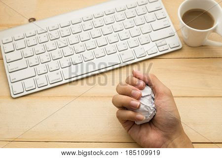 Top View. Young Woman Holding Garbage Paper In Her Hand And Have Keyboard, Coffee Cup With Coffee Pu