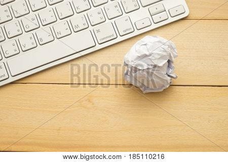 Op View. Round Garbage Paper Putting Beside Keyboard On Wooden Background. This Image For Technology