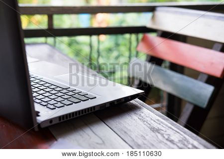 Computer Laptop Putting On Wooden Table Have Nature Are Background. This Image For Business And Tech