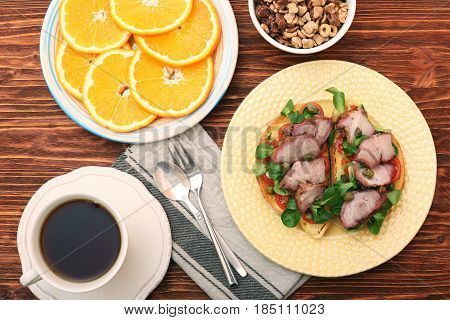 Open sandwich with pork greens and capers. Healthy breakfast concept.