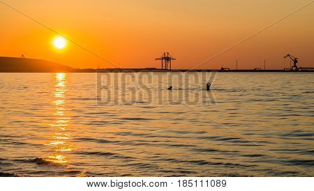 Couple bathing at sunset in the sea
