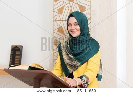 Muslim Woman Is Reading The Koran