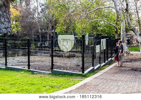 LOS ANGELES, CALIFORNIA - FEBRUARY 19, 2017:  Tourists view early excavation sites at the La Brea Tar Pits, an urban Ice Age fossil excavation site/museum.