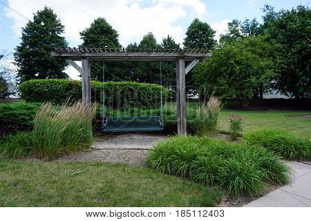 People may sit and swing in the swing arbor in Joliet, Illinois.