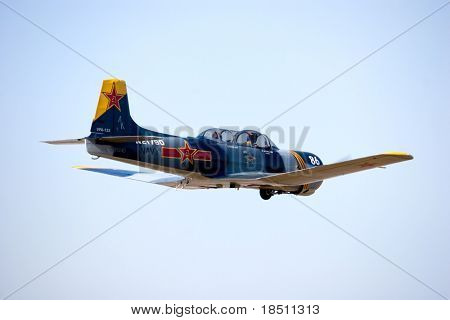 PALM COAST, FLORIDA - MARCH 27: A Chinese Nanchang CJ-6 trainer flys at the Wings Over Flagler Air Show at the Flagler County Airport on March 27, 2010 in Palm Coast, Florida.