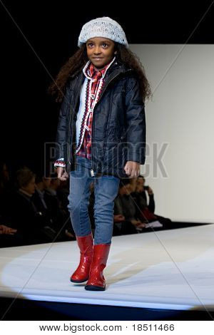 VALENCIA, SPAIN - JANUARY 22: Model Alicia Sanz, age 12, of Valencia on the catwalk for the Valencia Fashion Show with the designer Tumble'n Dry on January 22, 2010 in Valencia, Spain.
