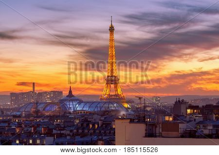 Paris France - December 28 2016: View of the Eiffel Tower on the background of the setting sun. Paris. France.