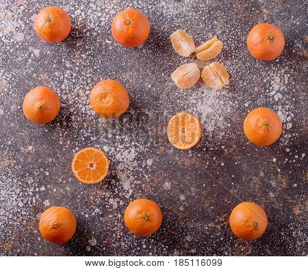 Delicious and beautiful Tangerines. Peeled Tangerine orange and Tangerine orange slices on a Dark Background. Citrus background Top view.