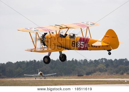 PALM COAST, FLORIDA - MARCH 27: A Bi-plane takes off at the Wings Over Flagler Air Show at the Flagler County Airport on March 27, 2010 in Palm Coast, Florida.