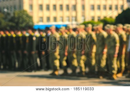 Blurred background military parade rows of soldiers at midday
