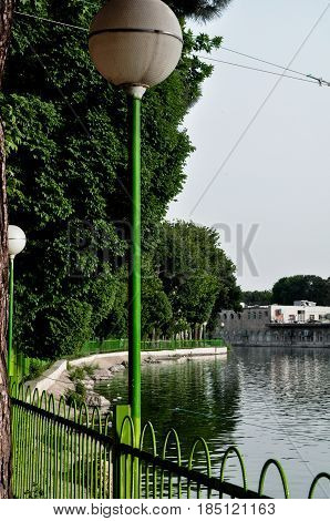 An old light bulb near a lake in the Iranian city of Tehran