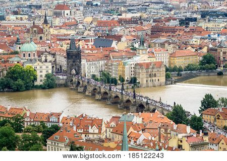 Aerial view of many tourists on the landmark Charles Bridge in Pargue Czech Republic.