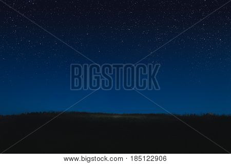 Photo of the night starry sky and horizon. Concept is stars in the sky