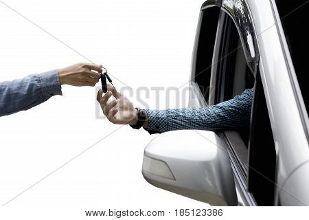 Close up of male hand giving new car key to customer isolated on white background