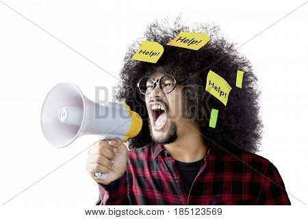 Afro man shouting by using megaphone with help word on sticky notes isolated on white background