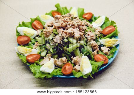 Salad with cucumber, boiled egg, tomato, cod liver, avocado, arugula. Fresh and healthy. Dietary food is prepared at home. Raw.