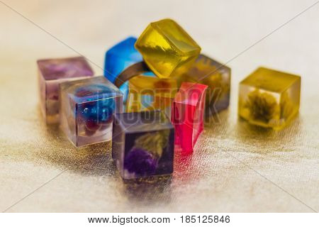 Crystal With Glitters And Flowers Made Of Epoxy Resin Close-up