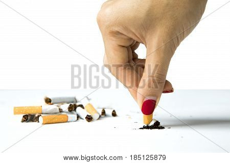 Woman destroying a cigarette in her hand concept of refuse bad habit isolated on white background