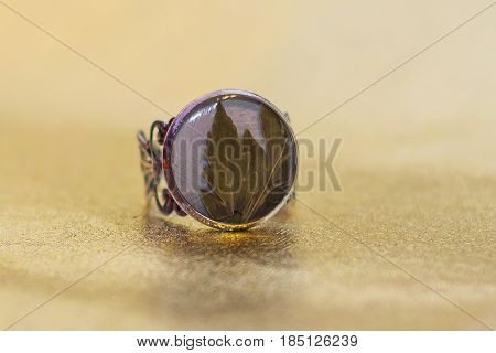 Ring With Crystal Made Of Epoxy Resin And Flower Close-up