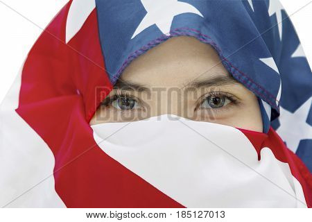 Image of young woman wearing veil made out from an American flag on the studio