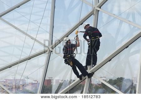 VALENCIA, SPAIN - MAY 03: Safety workers give a demonstration on climbing equipment at the Laboralia Work Place Safety Trade Show on May 3, 2011 in Valencia, Spain.