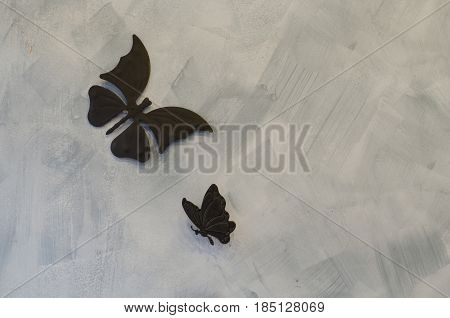 Iron butterfly on cement background, metal butterfly