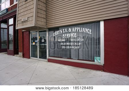 KALKASKA, MICHIGAN / UNITED STATES - NOVEMBER 27, 2016: Jerry's T.V. and Appliance Service, on Cedar Street in downtown Kalkaska, offers antenna installation and house calls.