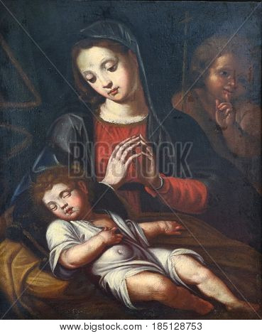 DUBROVNIK, CROATIA - NOVEMBER 08: Virgin with Child and Saint John the Baptist by the G. A. Sogliani from 16th century in the convent of the Friars Minor in Dubrovnik, November 08, 2016.