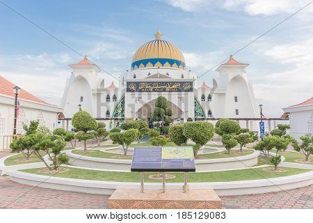 MALACCA, MALAYSIA - AUGUST 12, 2016: Melaka Strait Mosque (Masjid Selat) Malacca Malaysia taken during sunset