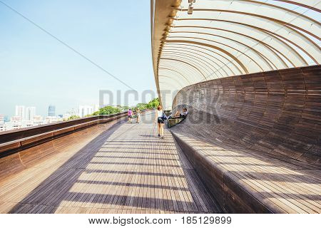 SINGAPORE - MAY 2, 2016: Singapore Henderson wave bridge at Mount Faber Park The Henderson Waves bridge is the highest pedestrian bridge in Singapore.;