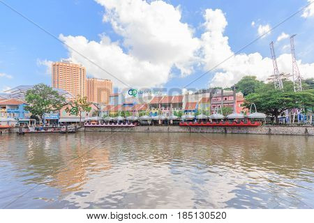 SINGAPORE - MAY 15: Colorful building and restaurants in Singapore River along Clarke Quay on May 15, 2016. The area used to be a commercial center during the colonial era.
