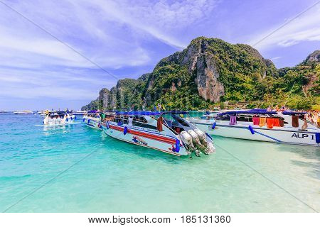 KOH PHI PHI, THAILAND - JULY 23: Motor boats on turquoise water of Maya Bay lagoon on July 23, 2016 in Koh Phi Phi island Thailand.