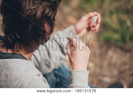 Man Lighting Up A Marihuana Or Hashish Joint Cigarette