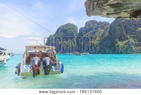 KOH PHI PHI THAILAND - JULY 23: Motor boats on turquoise water of Maya Bay lagoon on July 23 2016 in Koh Phi Phi island Thailand.