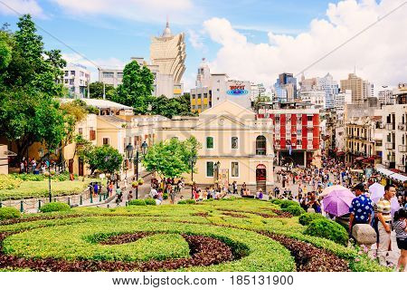 MACAU - NOVEMBER 16: Tourists visit the Historic Centre of ruined church of St Paul on November 16, 2015 in Macau China. The ruined church of St Paul was inscribed on the UNESCO World Heritage List in 2005.