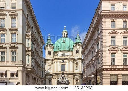 VIENNA AUSTRIA - APRIL 11 2016: Peterskirche (Saint Peter Church) is a Baroque Roman Catholic Parish Church in Petersplatz on Graben Street of Vienna City Austria