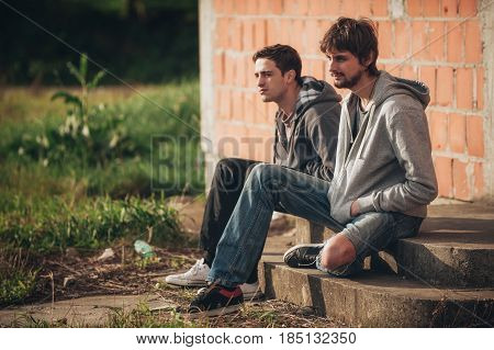 Two Depressed And Sad Young Buddies Friends Thinking About Problems