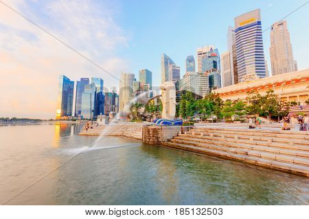 SINGAPORE - MAY 15, 2016: View of Singapore Merlion at Marina Bay against Singapore skyline. Merlion is a well-known tourist icon mascot and national personification of Singapore