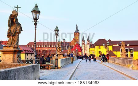 Wurzburg, Germany - April 21, 2013: The Old Main Bridge over the Main river in the Old Town of Wurzburg in the evening