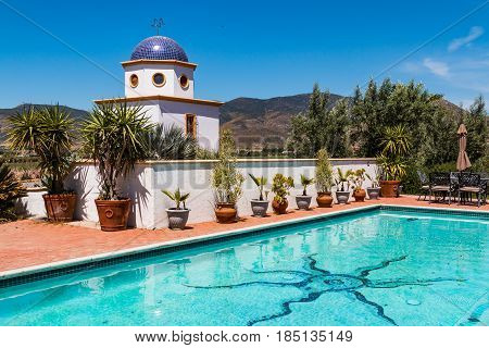 ENSENADA, MEXICO - MAY 3, 2017:  Pool area and domed building near the vineyards of the Adobe Guadalupe Winery in Baja California.