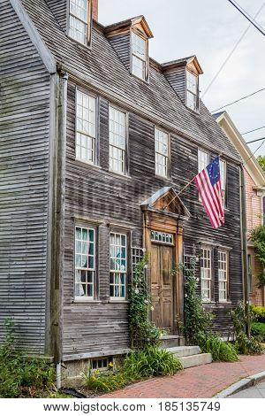 Historic New England style home displaying early American Flag in Portsmouth, NH, historic district