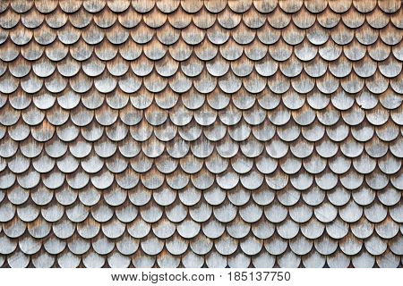 Traditional wooden shingles wall of an Austrian house