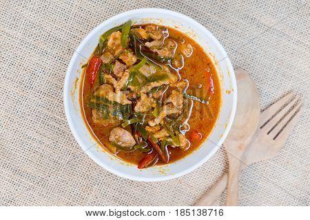 Pork in ground peanut-coconut cream curry or Thai say