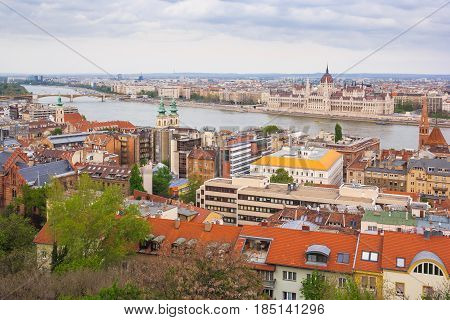 Budapest scene of downtown with Hungarian Parliament and Danube river. Budapest is the capital of European country Hungary and very popular travel destination for romantic trip.
